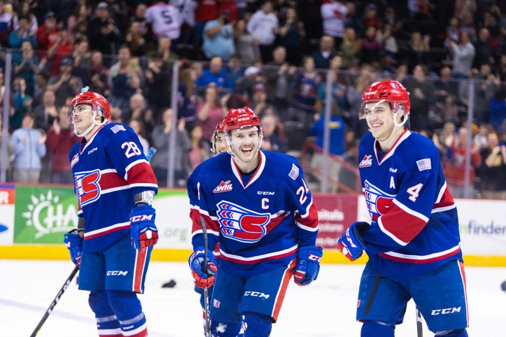 Three Spokane Chief hockey players celebrating